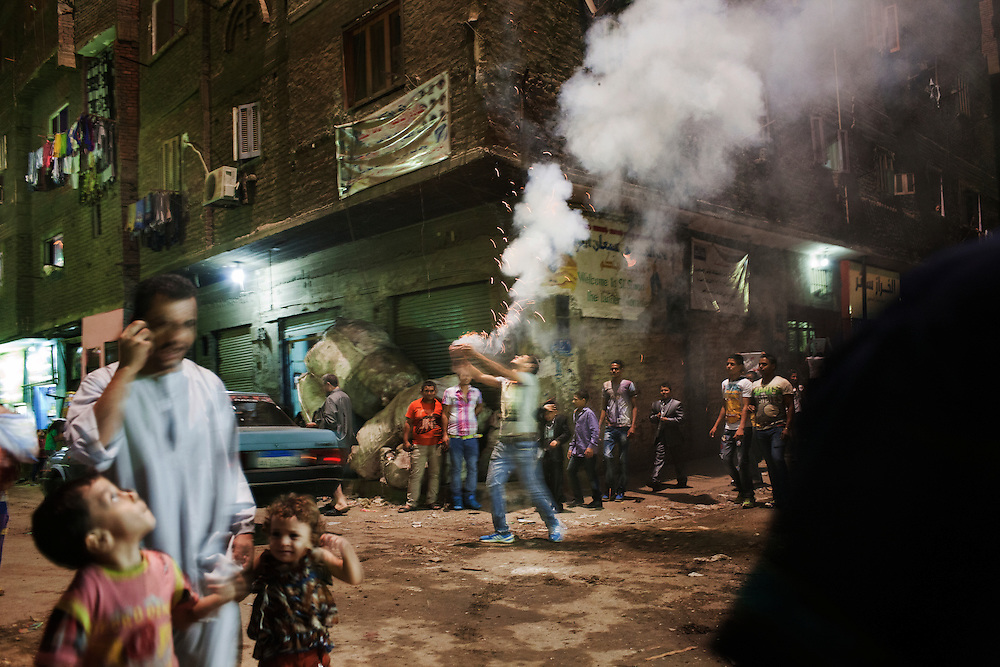 Fireworks to celebrate a wedding in garbage city, Cairo.<br />Garbage city, Mansheet Nasser, is a slum in Cairo inhabited by a community of about 50.000 Christians Copts mainly working in the activity of recycling the garbage. The Zabelleen, garbage pickers, collect the garbage of the whole city of Cairo and bring it to Garbage city where it were differentiated to be sold as raw material or recycled in the slum. Despite the unhealthy condition of life and work, the workers involved in this activity can earn until 60 egyptian pound a day (6 euro), more than public servants  minimum wage.