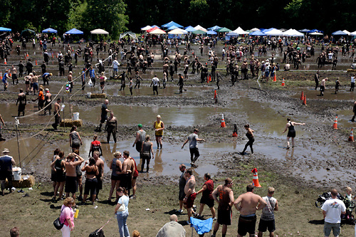 It can be a real challenge just getting around during MuddyGras, the 20th annual mud volleyball for Epilepsy at Wegerzyn Gardens MetroPark in Dayton, Saturday, July 10, 2010.