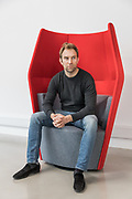 London, England, Uk, March 1,2019 - Portrait of What3words co-founder and CEO Chris Sheldrick at the headquarters of the company in West London.<br /> Founded in 2013, what3words developped a geocoding system for the communication of locations by 3 words, easier to remember and communicate than GPS numbers. Each words combination is linked to a 3 metres by 3 metres square. The software uses a grid of the world made up of 57 trillion squares.