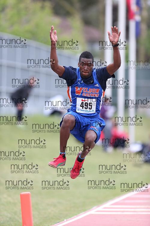 Akiel Archer of Donald A. Wilson SS - Whitby competes in the senior boys long jump at the 2013 OFSAA Track and Field Championship in Oshawa Ontario, Thursday,  June 6, 2013.<br /> Mundo Sport Images / Sean Burges