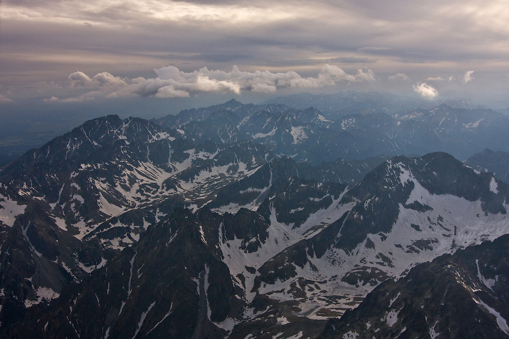 Aerial view of the High Tatras from east. On the background the Western Tatras. High Tatras, Slovakia. June 2009. Mission: Ticha