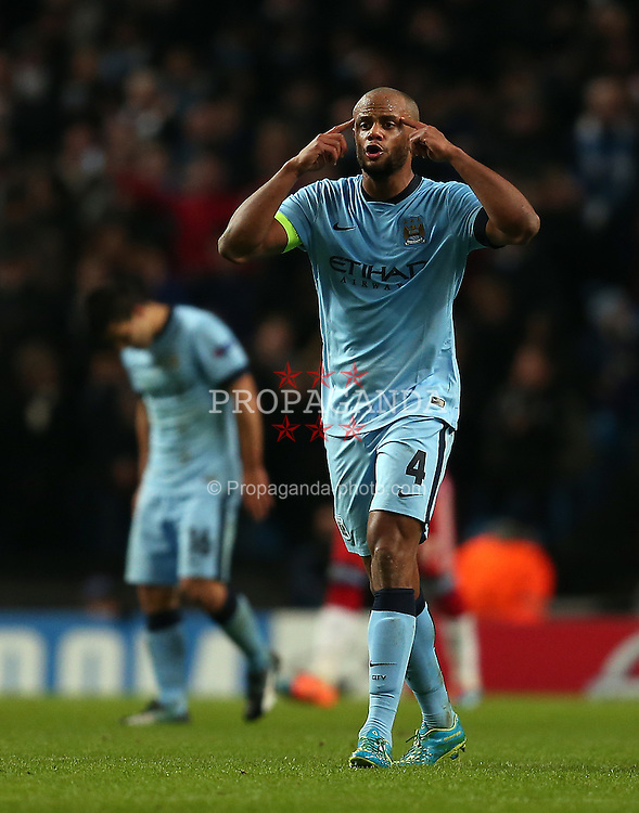 MANCHESTER, ENGLAND - Tuesday, November 25, 2014: Manchester City's Vincent Kompany gestures following his side's second goal during the UEFA Champions League Group E match at the City of Manchester Stadium. (Pic by Chris Brunskill/Propaganda)
