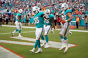 Miami Dolphins rookie outside linebacker Jerome Baker (55) dances and celebrates with Miami Dolphins outside linebacker Kiko Alonso (47) and Miami Dolphins defensive end Cameron Malveaux (75) after Baker intercepts a fourth quarter pass and returns it 25 yards good for a touchdown and a 13-3 Dolphins lead during the NFL week 9 regular season football game against the New York Jets on Sunday, Nov. 4, 2018 in Miami Gardens, Fla. The Dolphins won the game 13-6. (©Paul Anthony Spinelli)