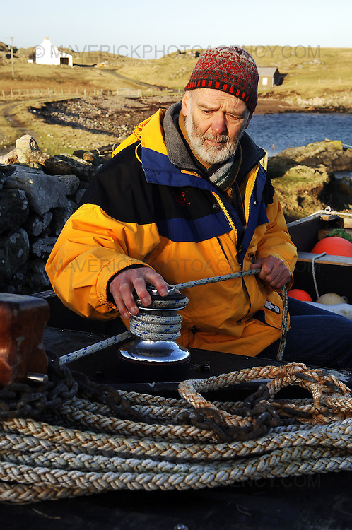Englishman Stuart Hill, who set up home in Shetland after getting shipwrecked on its shores, believes that the Crown never gained full ownership of the islands, which were handed to Scotland by a Norwegian King in the 1400s in lieu of a dowry for a royal wedding.  ..He has taken ownership of a tiny Shetland island called Forewick Holm, renaming it Forvik and calling for it to be recognised as a Crown dependency - Shetland, Scotland, UK - 25th January 2009. ..Pic shows Stuart Hill checking the rigging on his home made boat that he uses to travel to and from Forvik weather permitting.