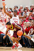 BLOOMINGTON, IN - JANUARY 12: Remy Abell #23 of the Indiana Hoosiers defends against Maverick Ahanmisi #13 of the Minnesota Golden Gophers at Assembly Hall on January 12, 2012 in Bloomington, Indiana. Minnesota defeated Indiana 77-74. (Photo by Joe Robbins)