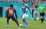 FC Barcelona defender Moussa Wague (16) pressures SSC Napoli defender Mario Rui (6) during a La Liga-Serie A Cup soccer match, Wednesday, Aug. 7, 2019, in Miami Gardens, Fla. FC Barcelona beat Napoli 2-1 (Kim Hukari/Image of Sport)