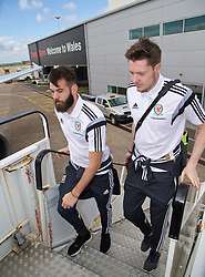 CARDIFF, WALES - Thursday, March 26, 2015: Wales' Joe Ledley and goalkeeper Wayne Hennessey board the flight at Cardiff Airport as the squad prepare to fly to Tel Aviv ahead of the UEFA Euro 2016 qualifying Group B match against Israel. (Pic by David Rawcliffe/Propaganda)