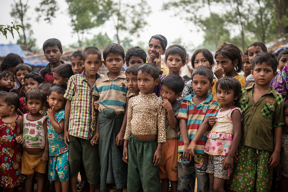 A large group of Rohingya boys and girls stand outdoors at Kutupalong refugee camp in Bangladesh. More than 600,000 Rohingyas currently live in Bangladesh, more than half of them children.
