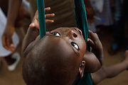 Ghana: 25 April 2012, A child sits in a sling while being weighed at the Dodowa new town health outreach point in Dodowa.The GAVI Alliance is a public-private partnership that brings together developing country and donor governments, WHO, UNICEF, the World Bank, the vaccine industry in both industrialised and developing countries, research and technical agencies, civil society, the Bill & Melinda Gates Foundation and other private philanthropists.  Set up in 2000 as the Global Alliance for Vaccines and Immunisation, GAVI's mission is to save children's lives and protect people's health by increasing access to immunisation in the world's poorest countries.