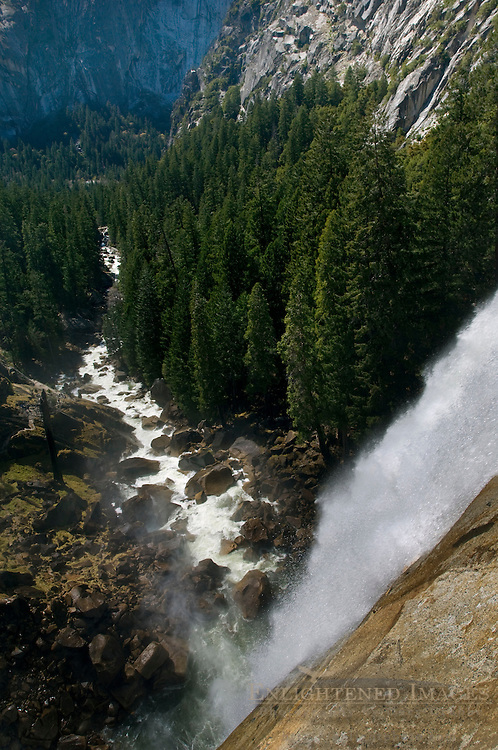 Overlooking the edge of Vernal Fall waterfall along the Merced River, Yosemite National Park, California
