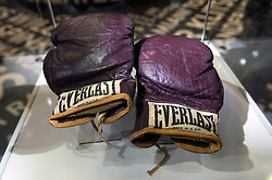 © Licensed to London News Pictures. 03/03/2016. A pair of boxing gloves worn by Muhammad Ali in a fight against Joe Frazier in 1973. The gloves feature in the I Am The Greatest  - Muhammad Ali Exhibition.  Exhibition featuring more than 100 artefacts from the boxer's career, put together with the help of the Ali family, showcased to celebrate the life of the former heavyweight champion giving an insight into one of the sport's most famous personalities. London, UK. Photo credit: Ray Tang/LNP