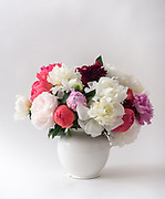 Silk rose flower bouquet on white background