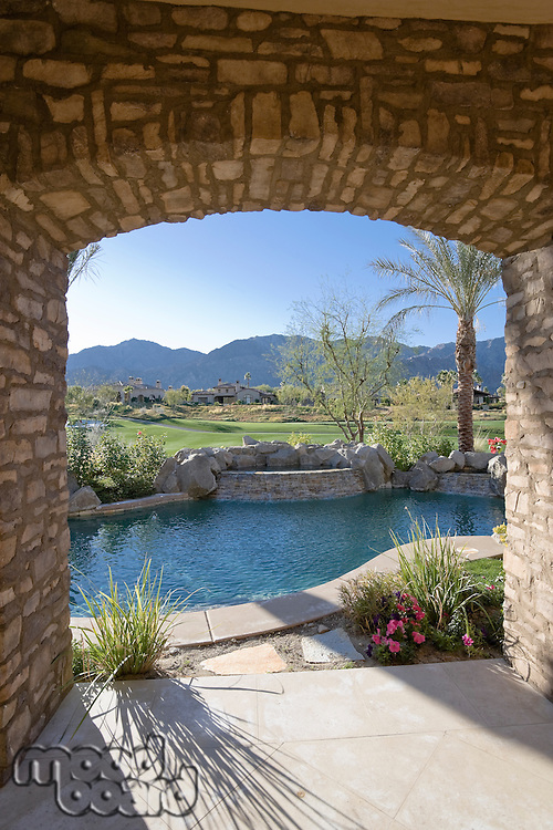 View of swimming pool with mountains in background from luxury villa