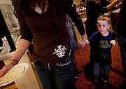 Spencer Nielsen, right, walks with his mother, Taryn, to watch his pizza be baked during lunch at BRIO Tuscan Grill in Murray, Friday, Nov. 9, 2012.