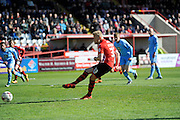 Exeter City's Jayden Stockley scores the equalising goal from the penalty spot to make the score 1-1 during the Sky Bet League 2 match between Exeter City and Morecambe at St James' Park, Exeter, England on 30 April 2016. Photo by Graham Hunt.