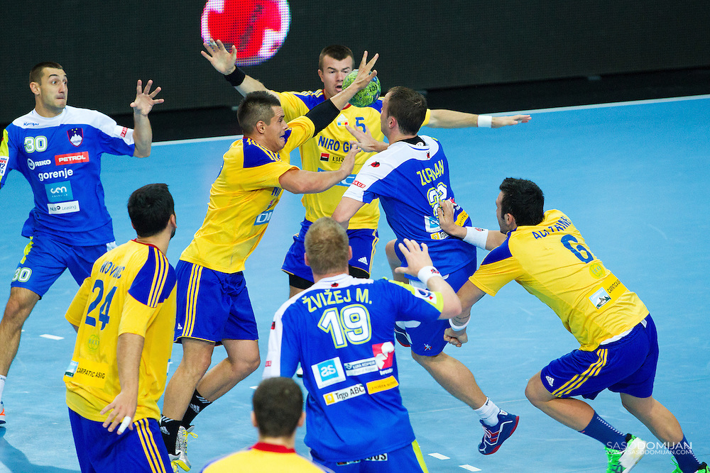 Matej Gaber of Slovenia, Miha Zvizej of Slovenia, Elmer Huba Talas of Romania and Dragan Gajic of Slovenia in action at qualifying match between Slovenia and Romania for EHF Handball European Championship 2014..© Saso Domijan