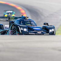 The Konica Minolta Business Solutions USA Cadillac DPI car practice for the Sahlen's Six Hours At The Glen at Watkins Glen International Raceway in Watkins Glen, New York.