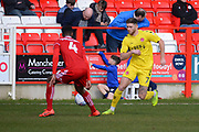 Fleetwood Town forward Wes Burns (7) takes the ball past Accrington Stanley defender Janoi Donacien (4) during the EFL Sky Bet League 1 match between Accrington Stanley and Fleetwood Town at the Fraser Eagle Stadium, Accrington, England on 30 March 2019.