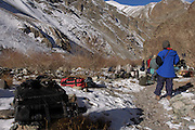 Leh - Tuesday, Dec 05 2006: The camp is broken down and bags await loading onto the mules that will carry them up to the second camp further into the Rumbak Valley in Hemis National Park. In the foreground is a Think Tank Airport Acceleration camera bag. (Photo by Peter Horrell / http://www.peterhorrell.com)
