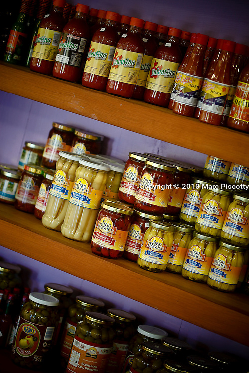 "SHOT 1/19/10 12:53:24 PM - Local Mexican food products for sale in Sayulita, Mexico. Sayulita is a small fishing village about 25 miles north of downtown Puerto Vallarta in the state of Nayarit, Mexico, with a population of approximately 4,000. Known for its consistent river mouth surf break, roving surfers ""discovered"" Sayulita in the late 60's with the construction of Mexican Highway 200. In recent years, it has become increasingly popular as a holiday and vacation destination, especially with surfing enthusiasts and American and Canadian tourists. (Photo by Marc Piscotty / © 2009)"