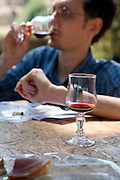 young male person taking a sip of his wine