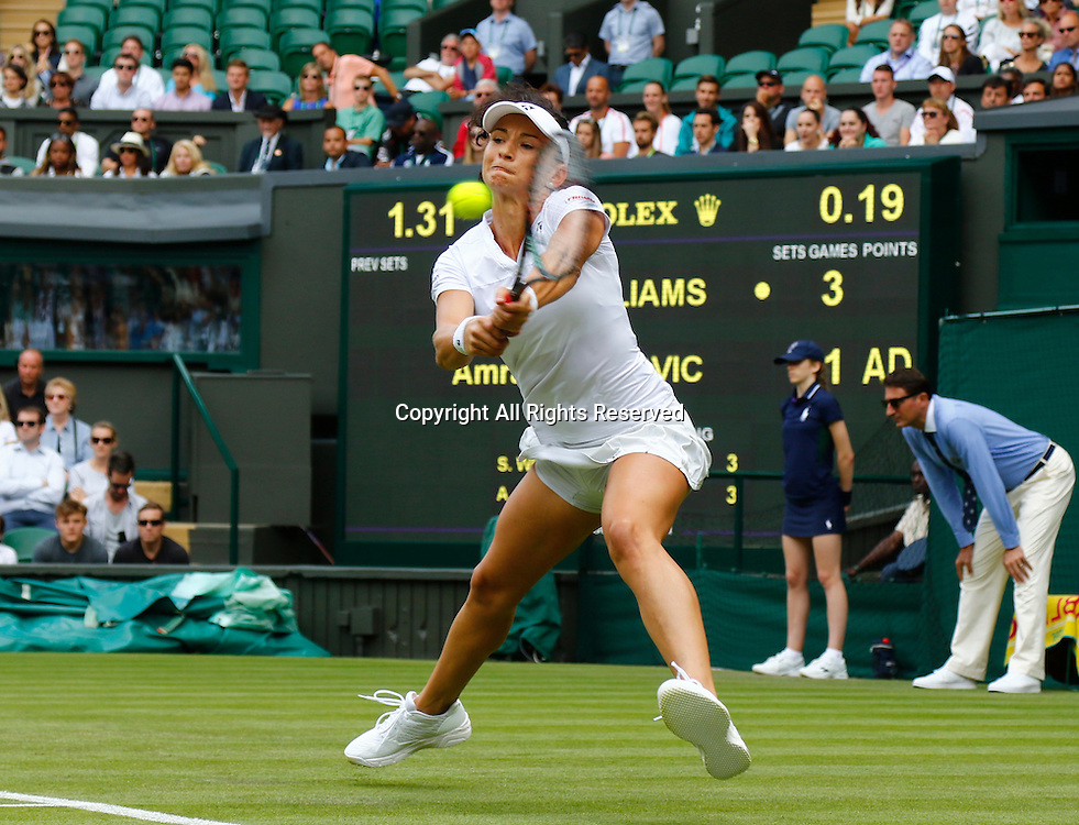 28.06.2016. All England Lawn Tennis and Croquet Club, London, England. The Wimbledon Tennis Championships Day Two. Amra Sadikovic (SWI) hits a backhand during her singles match against number 1 seed Serena Williams (USA).