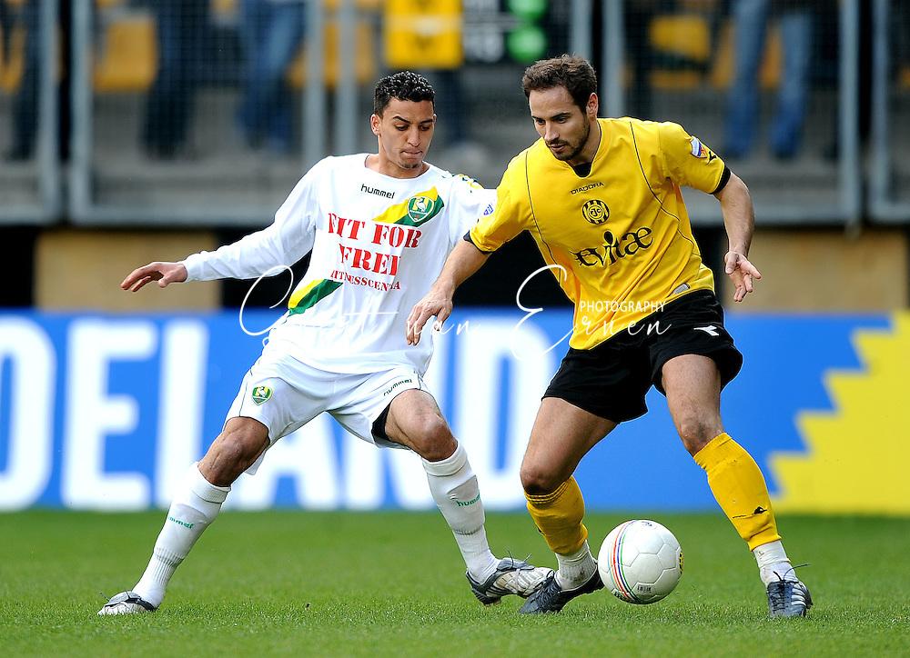 22-03-2009 Voetbal:Roda JC:Ado Den Haag:Kerkrade<br /> Bodor in duel met Karim Soltani<br /> Foto: Geert van Erven