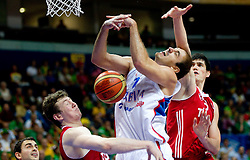 Nenad Krstic of Serbia between Omer Asik of Turkey and Ersan Ilyasova of Turkey during basketball game between National basketball teams of Serbia and Turkey at FIBA Europe Eurobasket Lithuania 2011, on September 11, 2011, in Siemens Arena,  Vilnius, Lithuania. Serbia defeated Turkey 68-67. (Photo by Vid Ponikvar / Sportida)
