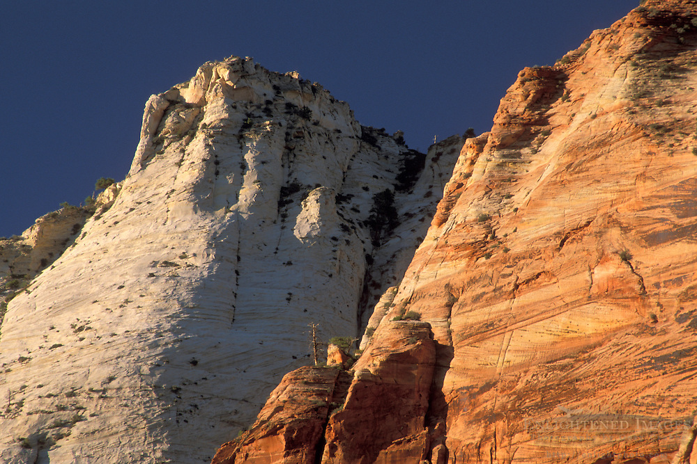 Sunset on sandstone rock cliffs along the Zion - Mt. Carmel Highway, Zion National Park, Uath