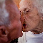 Mary gives Bernard a kiss. She often thinks Bernard is her son and scolds him, however, he is one of her only links to reality. He doesn't want to put her in a nursing home because he wants her at home where he can take care of her. The ammount of care she requires is becoming more demanding on him and his patience everyday.
