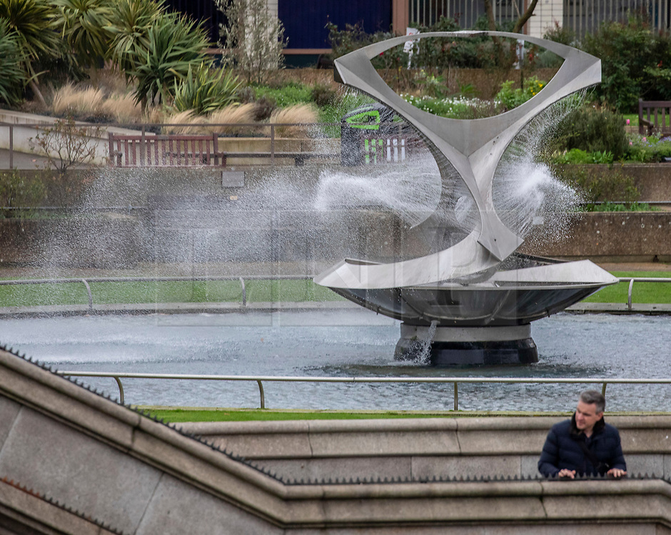 © Licensed to London News Pictures. 09/02/2020. London, UK. Fountains at St Thomas's Hospital blow in the wind as Storm Ciara hits London and the South East. All 8 Royal Parks closed their gates this morning to the public as weather experts predict stormy weather with very high winds and heavy rain for Sunday. Photo credit: Alex Lentati/LNP