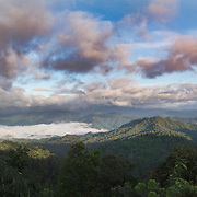 "Panoramic rainy season view of the higher elevations of Kaeng Krachan National Park from Panoenthung. The famous ""Sea of fog"" is visible in the photograph."