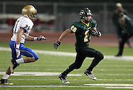 Kennedy's Alexander Hillyer (28) tries to get around Wahlert's Alex Perry (21) during the first half of the game between Cedar Rapids Kennedy and Dubuque Wahlert at Kingston Stadium in Cedar Rapids on Friday night, October 21, 2011.