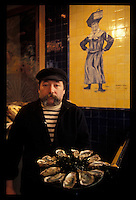 Oysterman in a Paris seafood restaurant - Photograph by Owen Franken
