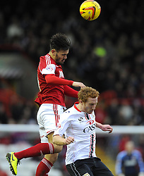 Bristol City's Marlon Pack battles for the high ball with Milton Keynes Dons' Dean Lewington - Photo mandatory by-line: Joe Meredith/JMP - Tel: Mobile: 07966 386802 18/01/2014 - SPORT - FOOTBALL - Ashton Gate - Bristol - Bristol City v MK Dons - Sky Bet League One