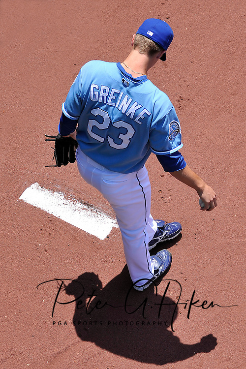 Starting pitcher Zack Greinke #23 of the Kansas City Royals warms up in the bullpen before a game against the Chicago White Sox at Kauffman Stadium in Kansas City, Missouri.  ..