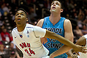 GARLAND, TX - NOVEMBER 11: Ben Moore #34 of the SMU Mustangs boxes out Gilvydas Biruta #55 of the Rhode Island Rams on November 11, 2013 at the Curtis Culwell Center in Garland, Texas.  (Photo by Cooper Neill/Getty Images) *** Local Caption *** Ben Moore; Gilvydas Biruta