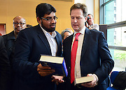 "© Licensed to London News Pictures. 24/05/2013. London, UK Nick Clegg is handed books a the meeting by a member of the audience. one of the books was titled ""FATWA on Terrorism and Suicide Bombings "". Nick Clegg, Liberal Democrat MP and Deputy Prime Minister, attends a multi faith gathering with the local multi faith community at the Hugh Cubitt Peabody Centre in Islington London today 24th May 2013. After meeting privately with political and faith leaders he and they made speeches in response to the attack and death of Drummer Lee Rigby in Woolwich, calling for the community to unite against the attack. Photo credit : Stephen Simpson/LNP"