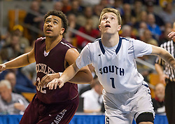Woodrow Wilson guard Tarek Payne (32) and Parkersburg South forward Cole Day (1) fight for space to rebound during a foul shot during a semi-final game at the Charleston Civic Center.