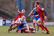 Halifax RLFC interchange Dan Fleming (29) is stopped  during the Betfred Championship match between Halifax RLFC and London Broncos at the MBi Shay Stadium, Halifax, United Kingdom on 8 April 2018. Picture by Simon Davies.