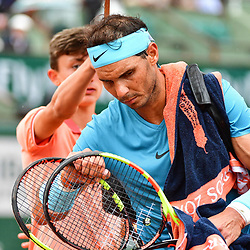 Rafael Nadal of Spain gathers his things as rain interrupts play during Day 11 of the French Open 2018 on June 6, 2018 in Paris, France. (Photo by Dave Winter/Icon Sport)