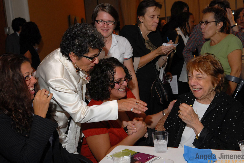 Katherine, standing, introduces Michele James (standing in white shirt) and Mariam Habib (kneeling in pink sweater) to her aunt Gloria Rintrona (seated right), and cousin Janelle Rintrona (seated left) ...People gather for the celebration of the 20th anniversary of Katherine Acey's position as Executive Director of the Astraea Lesbian Foundation for Justice at the 1199 penthouse at 330 West 42nd Street in New York City on October 10, 2007. ..Photo by Angela Jimenez