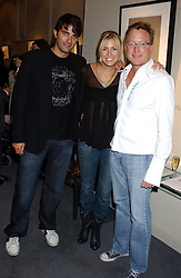 Left to right, STEPHEN SOLAKA,  fiance NICOLE KING and musician MICHAEL GLEASON at a private view of fashion designer Lindka Cierach's Couture Dresses drawn by Trudy Good held at the Belgravia Gallery, 45 Albemarle Street, London on 21st September 2005.<br /><br />NON EXCLUSIVE - WORLD RIGHTS