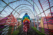 UNITED KINGDOM, Glastonbury: 22 June 2016 A festival goer makes her way through a purgatory at Glastonbury Festival this evening . Rick Findler / Story Picture Agency