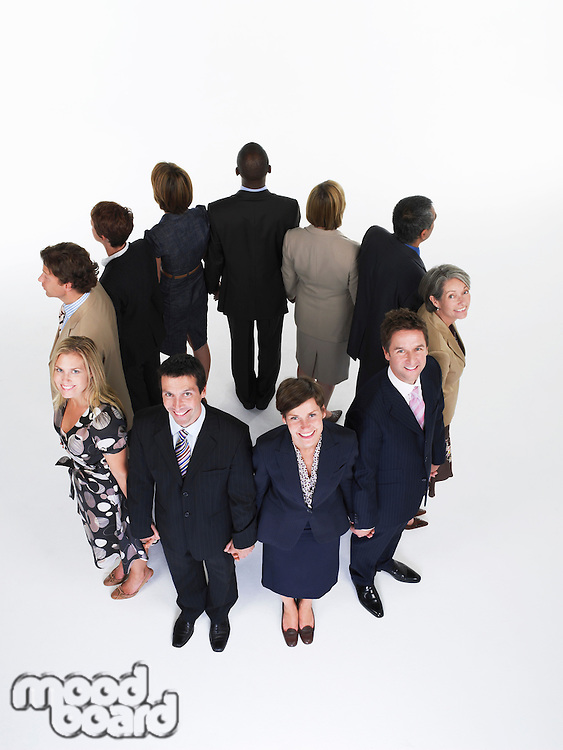 Group of Businesspeople Holding Hands looking out