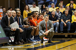 Dec 5, 2017; Morgantown, WV, USA; Virginia Cavaliers head coach Tony Bennett kneels along the bench during the first half against the West Virginia Mountaineers at WVU Coliseum. Mandatory Credit: Ben Queen-USA TODAY Sports