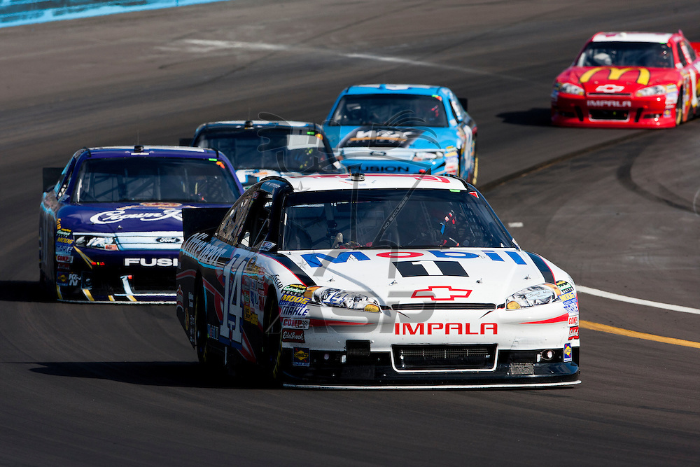Avondale, AZ - NOV 13, 2011:  The NASCAR Sprint Cup Series teams take to the track for the Kobalt Tools 500 race at the Phoenix International Raceway in Avondale, AZ.