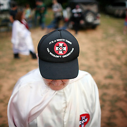Kyle Green | The Roanoke Times<br /> 7/2/2011 A member of the Rebel Brigade KKK group in Martinsville, Virginia wears a hat that says &quot;Its a white thing. You wouldn't understand&quot; before one of six cross burnings held on rural land in southwest Virginia. The KKK is making a comeback in the USA helped by high unemployment and a growing distrust in the government.