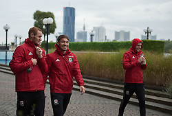 VIENNA, AUSTRIA - Thursday, October 6, 2016: Wales' Shaun MacDonald with Tom Bradshaw and Chris Gunter lead the Wales team during a pre-match walk at the Hilton Danube Waterfront Hotel ahead of the 2018 FIFA World Cup Qualifying Group D match against Austria. (Pic by Peter Powell/Propaganda)