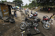 Street side motorcycle mechanic. Kinshasa, Democratic Republic of Congo...Zute & Demelza Lightfoot.www.lightfootphoto.com